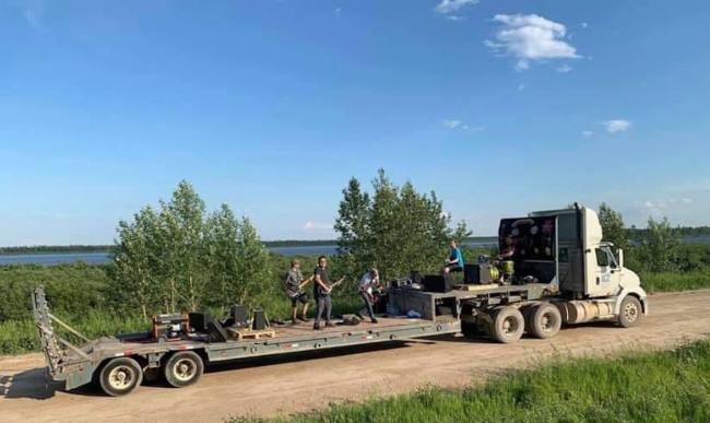 a band plays in the back of a truck