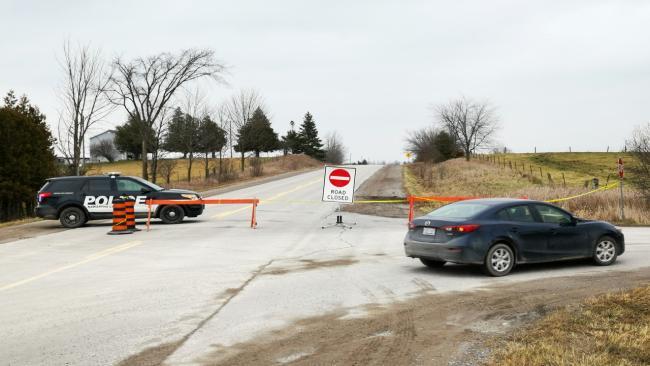 A car turns at a road block