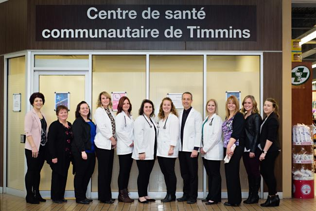 people posing in front of Centre de sante communautaire de Timmins