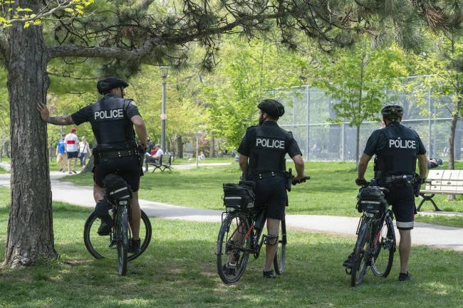 bicycle police offers at Trinity Bellwoods Park, in Toronto