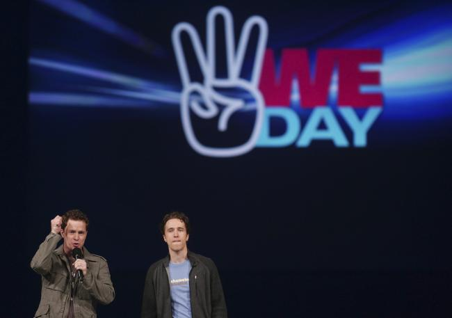 Marc and Craig Kielburger on stage at the WE Day celebrations