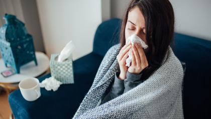 person feeling sick from the article 'We need them now': Advocates call for employer-provided paid sick days