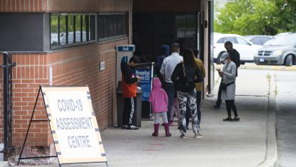 people line up outside a COVID testing centre from the article There's only so much testing to go around. Ontario will have to make tough choices
