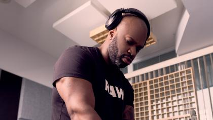 DJ Demuir with headphones on from the article 'Dance music has always been political': A new EP honours Black Lives Matter