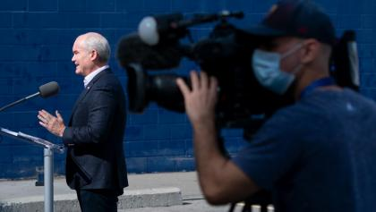 Man in background talks into microphone while man with video camera shoots in the foreground from the article ON the campaign trail: The week that was (September 13-17)