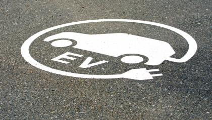 logo for an EV charging station painted on the street from the article Are the Tories getting more serious about tackling climate change?