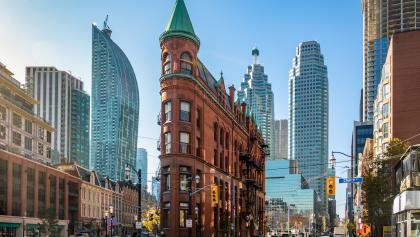a downtown street with skyline from the article Toronto may never recover from COVID-19