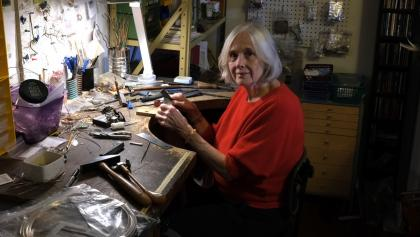 a woman sits in a jewellery workshop from the article What new Ontario-led research says about mesothelioma