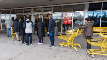 line-up to enter a grocery store from the article TVO.org daily: Friday, March 27