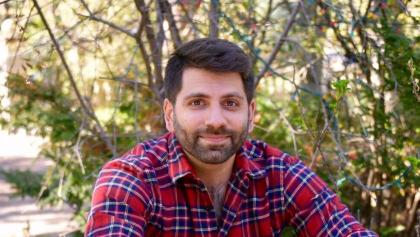 closeup of a man in a plaid shirt sitting in front of a tree from the article These Ontario experts are calling for universal dental care