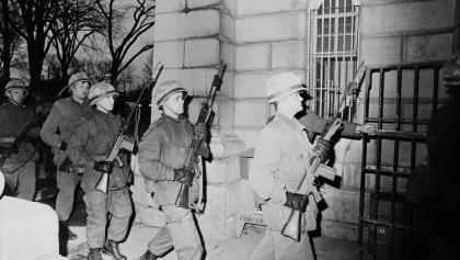 soldiers marching with guns from the article Looking back on the shocking Kingston Pen riot of 1971