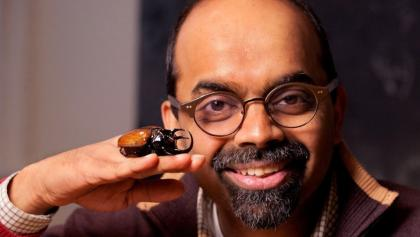 Man posing with a large beetle on his hand.  from the article Everything you wanted to know about morphogenesis but were afraid to ask