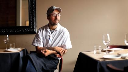 a man seated at a restaurant table from the article 'We need one voice': Independent restaurateurs are fighting for their industry's survival