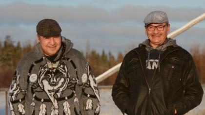 two smiling men stand side by side from the article 'I'll cry with you, laugh with you': Finding hope through traditional Indigenous healing