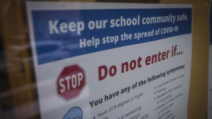 "sign reading ""keep our school community safe,"" with info about COVID-19 from the article Why Ontario's school plan could become a nightmare scenario for the Tories"