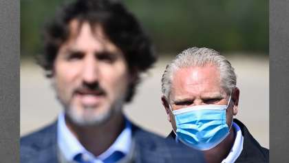 closeup of two men, one wearing a mask from the article Why Doug Ford should do the unthinkable: introduce a carbon tax