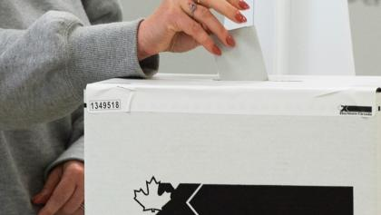 Woman's hand puts ballot in ballot box. from the article ON the campaign trail: The week ahead (September 20-24)