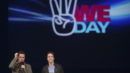 Marc and Craig Kielburger on stage at the WE Day celebrations  from the article A 'celebration of young leaders' becomes a scandal for old political families